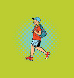 boy student with a backpack goes to school or vector image
