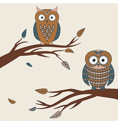 two cute colorful owls sitting on a branc vector image