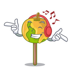 Listening music candy apple mascot cartoon vector