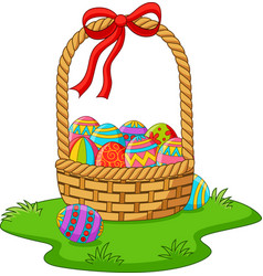 basket with easter eggs in the grass vector image