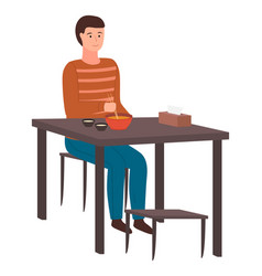 man sitting at table eating delicious japanese vector image