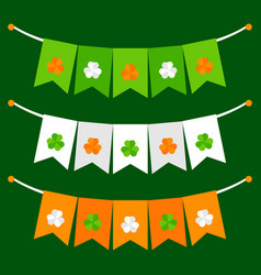 Colorful festive bunting with clover on green vector