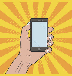 hand holds a mobile phone pop art comic style vector image