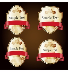 Set of gold ornate labels with red tape vector image