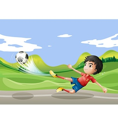 A player playing soccer at the street vector image