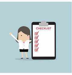 businesswoman completing a checklist ticking vector image