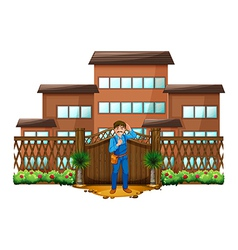 A carpenter in front of the house with a wooden vector image