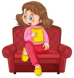 little girl on sofa eating snack on white vector image