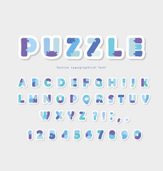 puzzle paper cut out font in blue colors vector image