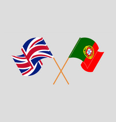 Crossed and waving flags portugal and uk vector