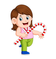 a girl holding big christmas candy cane vector image