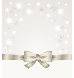 Silver ribbon and bow with stars and snow flakes vector
