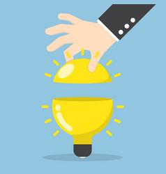 businessman hand open the light bulb vector image