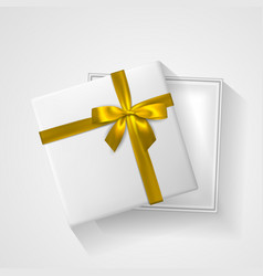 White open gift box with bow and ribbon top view vector