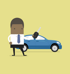 african businessman holding a key of a new car vector image