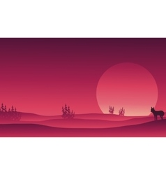 Silhouette of wolf in hills scenery vector image