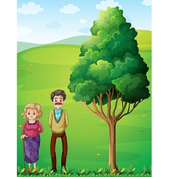 Grandparents at the hilltop near the tree vector