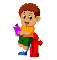 happy boy reading book vector image