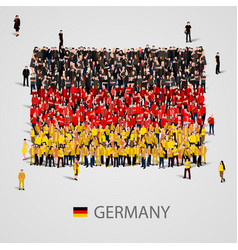 Large group of people in the germany flag shape vector