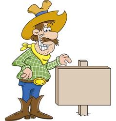 Cartoon Cowboy with a Sign vector image vector image