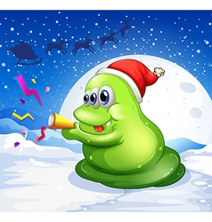 A monster with a red hat playing at the snowy land vector image