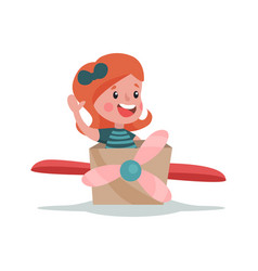 Adorable little girl playing with cardboard vector