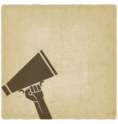hand with megaphone symbol old background vector image vector image