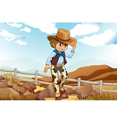 An adventurer above the hill near the rocky area vector