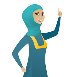 young muslim business woman pointing her finger up vector image