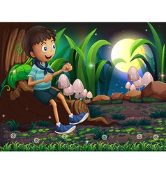 A young boy sitting above the roots of a giant vector