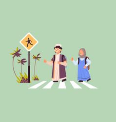 arab schoolchildren crossing road on crosswalk vector image