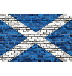 Grunge flag of Scotland on a brick wall vector image