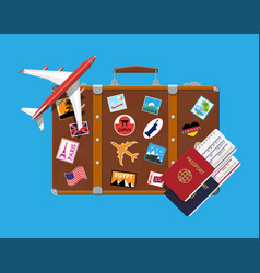 Travel suitcase with stickers and aircraft vector