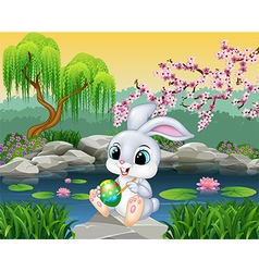 Carton happy Easter Bunny painting an egg vector