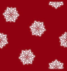 red seamless pattern with a snowflake vector image