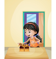 A girl unwrapping a gift vector