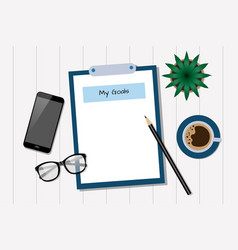 my goals - blank notepad with smart phone and a vector image