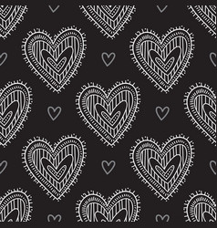 White boho ornamental hearts on black background vector