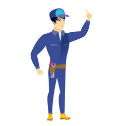 asian mechanic pointing with his forefinger vector image