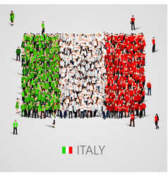 large group of people in the italy flag shape vector image