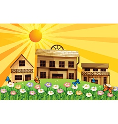 A garden at the hills near the wooden houses vector image vector image