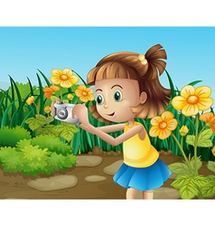 A girl taking photos at the garden vector