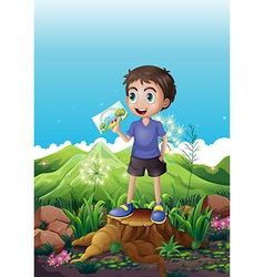 A boy holding a picture standing above a stump vector