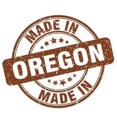 Made in oregon brown grunge round stamp vector
