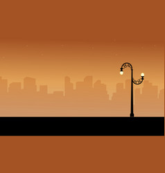 Silhouette of city with street lamp style scenery vector