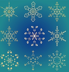 Set hand-drawn doodles gold colored snowflake vector image