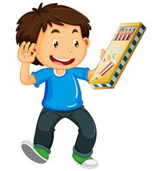 Boy holding pencil case vector