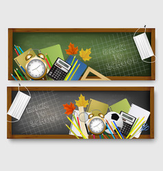 Two back to school banners with school supplies vector