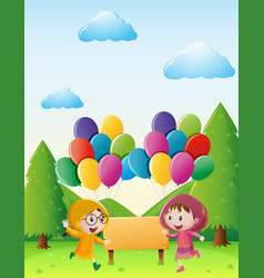 Two girls in raincoat in the park vector