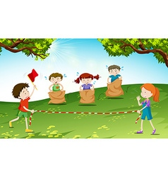 Children playing game at the field vector image